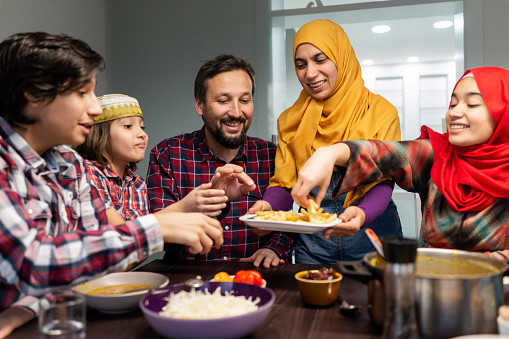 Muslim family eating together