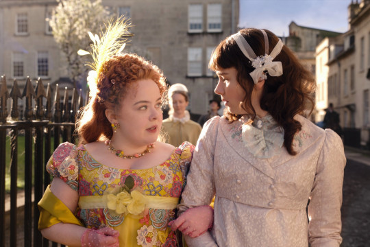 NICOLA COUGHLAN as PENELOPE FEATHERINGTON and CLAUDIA JESSIE as ELOISE BRIDGERTON in episode 2 of BRIDGERTON