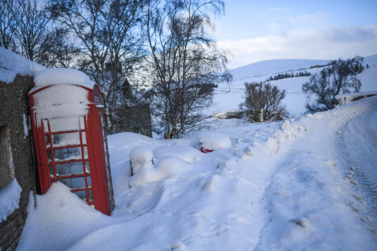 A phone box is seen covered in snow on February 8, 2021 in Cabrach, United Kingdom.