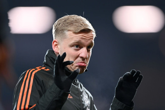 Donny van de Beek of Manchester United warms up prior to the Premier League match between Manchester United and Sheffield United at Old Trafford on January 27, 2021 in Manchester, England. Sporting stadiums around the UK remain under strict restrictions due to the Coronavirus Pandemic as Government social distancing laws prohibit fans inside venues resulting in games being played behind closed doors.
