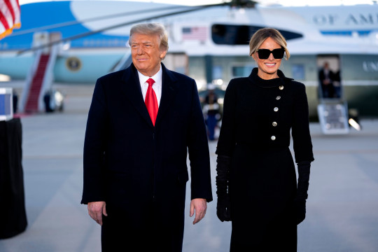 Marine One, with U.S. President Donald Trump and U.S. First Lady Melania Trump on board, arrives to a farewell ceremony at Joint Base Andrews, Maryland, U.S., on Wednesday, Jan. 20, 2021. Trump departs Washington with Americans more politically divided and more likely to be out of work than when he arrived, while awaiting trial for his second impeachment - an ignominious end to one of the most turbulent presidencies in American history. Credit: Stefani Reynolds / Pool via CNP. 20 Jan 2021 Pictured: U.S. President Donald Trump, left, and U.S. First Lady Melania Trump, arrive to a farewell ceremony at Joint Base Andrews, Maryland, U.S., on Wednesday, Jan. 20, 2021. Trump departs Washington with Americans more politically divided and more likely to be out of work than when he arrived, while awaiting trial for his second impeachment - an ignominious end to one of the most turbulent presidencies in American history. Credit: Stefani Reynolds / Pool via CNP. Photo credit: Stefani Reynolds - Pool via CNP / MEGA TheMegaAgency.com +1 888 505 6342