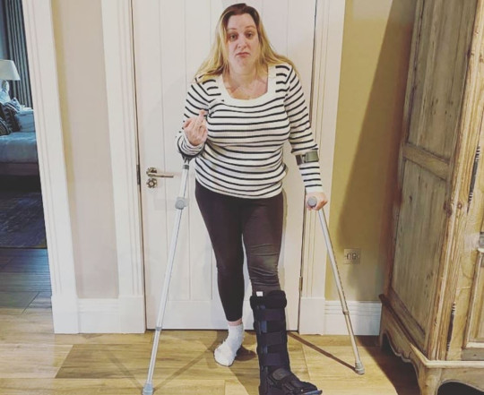 Daisy May Cooper on crutches