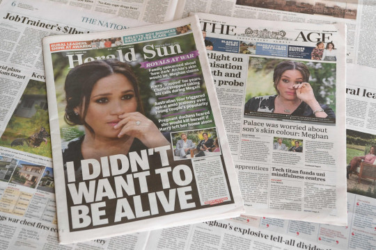 A photo taken in Melbourne on March 9, 2021 shows front page headlines reporting on the story of the interview given by Meghan, Duchess of Sussex, wife of Britain's Prince Harry, Duke of Sussex, to Oprah Winfrey, which aired on US broadcaster CBS. (Photo by William WEST / AFP) (Photo by WILLIAM WEST/AFP via Getty Images)