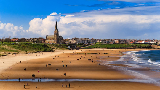 Tynemouth Beach. Longsands beach looking north towards St George's church.