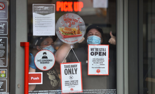 STOKE-ON-TRENT, UNITED KINGDOM - NOVEMBER 05: Workers from American fast food restaurant chain KFC, are seen as England enters a second national coronavirus lockdown today on November 05, 2020 in Stoke-on-Trent, Staffordshire, United Kingdom. England enters second national coronavirus lockdown today. People are still permitted to exercise with one other person, takeaway food is permitted but bars and restaurants are shut for sit-in service. Schools will remain open but people are being advised to work from home where possible and only undertake necessary travel. All non-essential shops are closed with supermarkets and builders' merchants remaining open. (Photo by Nathan Stirk/Getty Images)