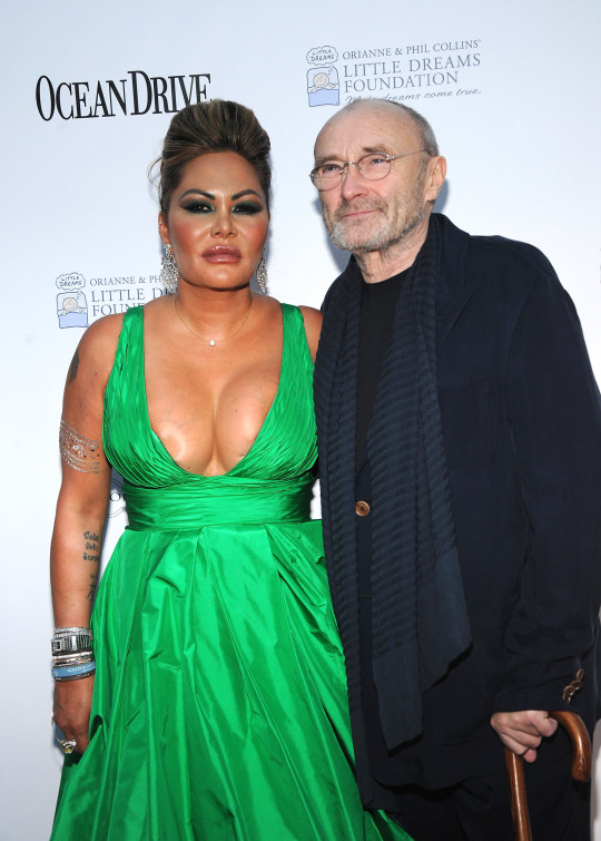 Orianne Cevey and Phil Collins on red carpet