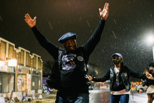 Chairman of the Black Panther Party Cubs, Fred Hampton Jr. (C), reacts in the intersection of 38th Street and Chicago Avenue during a thunderstorm on April 5, 2021 in Minneapolis, Minnesota.