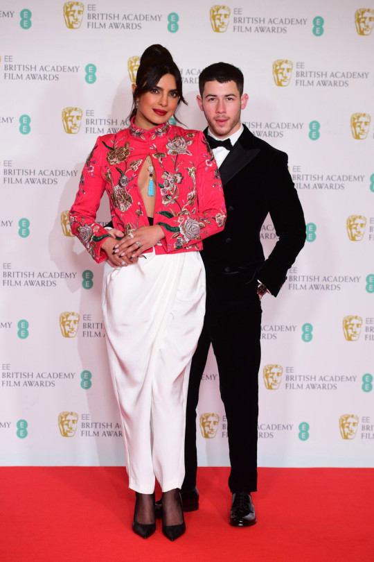 Priyanka Chopra Jonas and her husband Nick Jonas arrives for the EE BAFTA Film Awards at the Royal Albert Hall in London. Picture date: Sunday April 11, 2021. PA Photo. Photo credit should read: Ian West/PA Wire