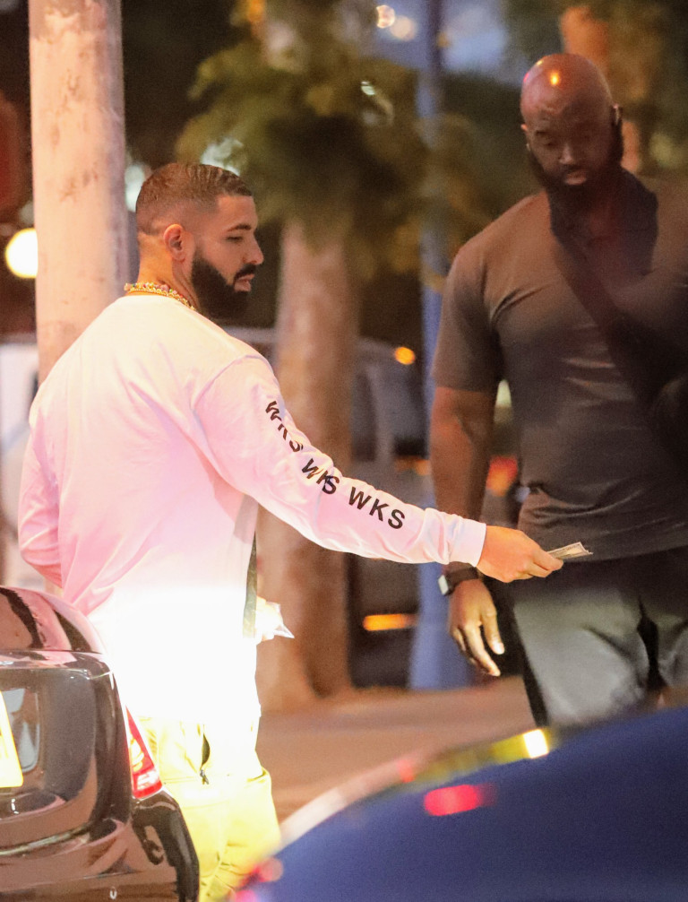 Drake seen helping a man with a few hundred dollar bills after long night in the studio