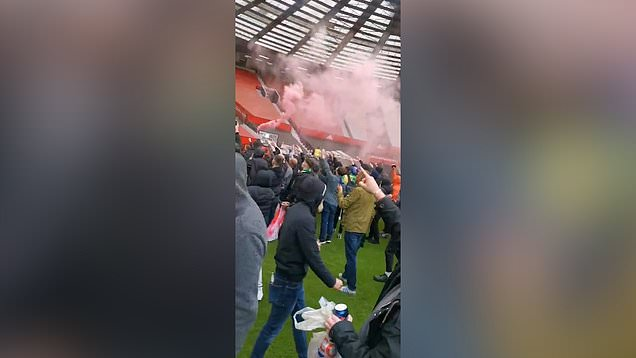 Man United fans storm Old Trafford in club owner protest