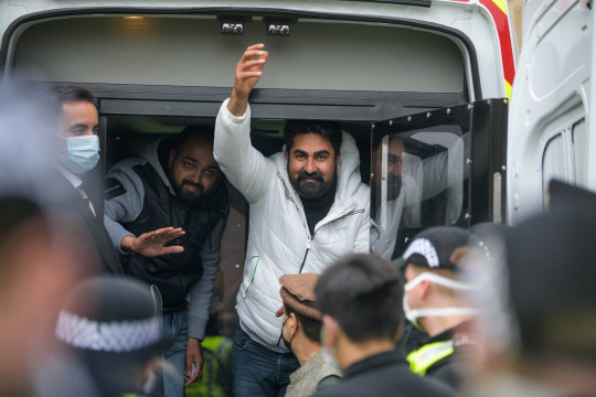Members of the public and the police were in a standoff today (Thursday) in Glasgow's Southside after immigration officials tried deport individuals in a morning raid on a flat . Since early morning a crowd has gathered and stopped an immigration from leaving the area with dozens of police officers now in attendance Human rights lawyer Aamer Anwar and human rights activist Mohammad Asif (Afghan hat) with the two men that were detained , being released from the Immigration van and escorted to the Madrasa Taleem ul Islam Copyright ?? Wattie Cheung??????13/5/21 First Use Only ,Editorial Use Only, All reproduction fees payable,No Syndication ??Wattie Cheung tel 07774 885266 email.... wattiecheung@mac.com
