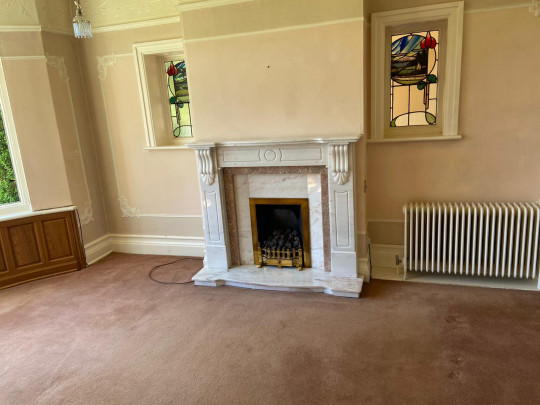 fireplace in lounge in victorian house before makeover