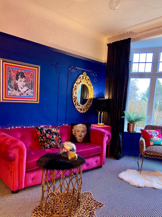 pink sofa and cobalt blue wall in transformed living room