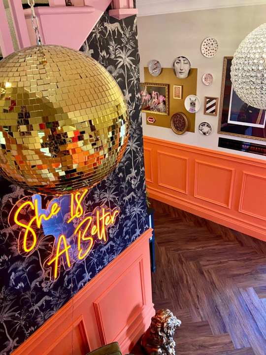 disco ball in hallway after home renovation