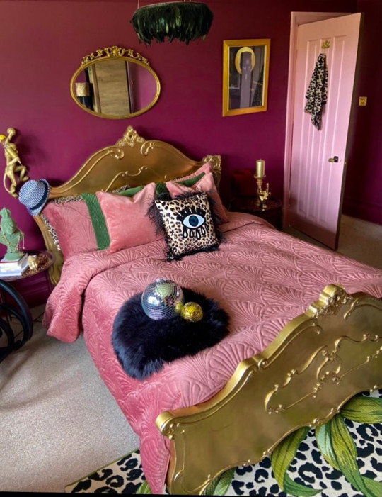 pink and burgundy bedroom in renovated house