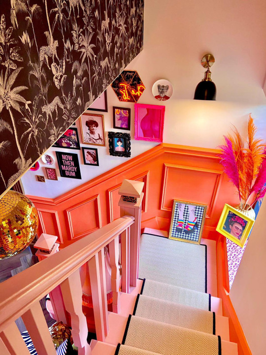 pink staircase in renovated home