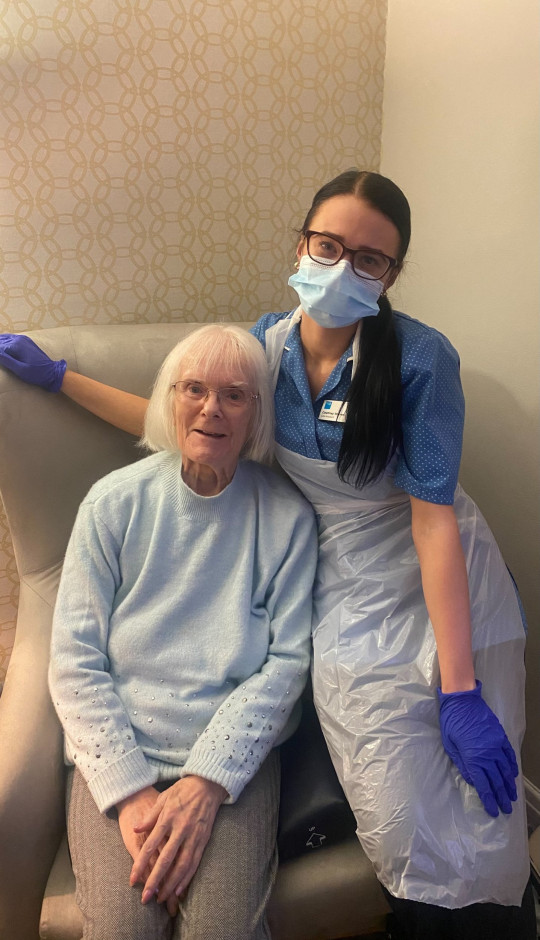 Courtney Warren at work in a care home with elderly resident