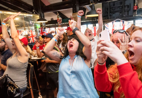 SANTA ANA, CA - JULY 02: Gywn Tye, center, of Huntington Beach reacts while watching the U.S. vs. England in the Women's World Cup semifinal match at The Olde Ship British Pub and Restaurant in Santa Ana on Tuesday, July 2, 2019. (Photo by Leonard Ortiz/MediaNews Group/Orange County Register via Getty Images)