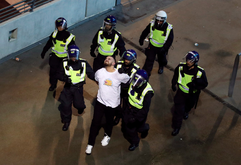 Police detained an England fan outside Wembley stadium during the Euro 2020 final against Italy.