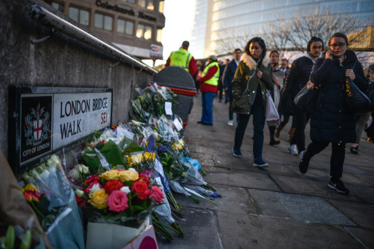 Floral tributes are left for Jack Merritt and Saskia Jones, who were killed in a terror attack, on December 2, 2019 in London, England.
