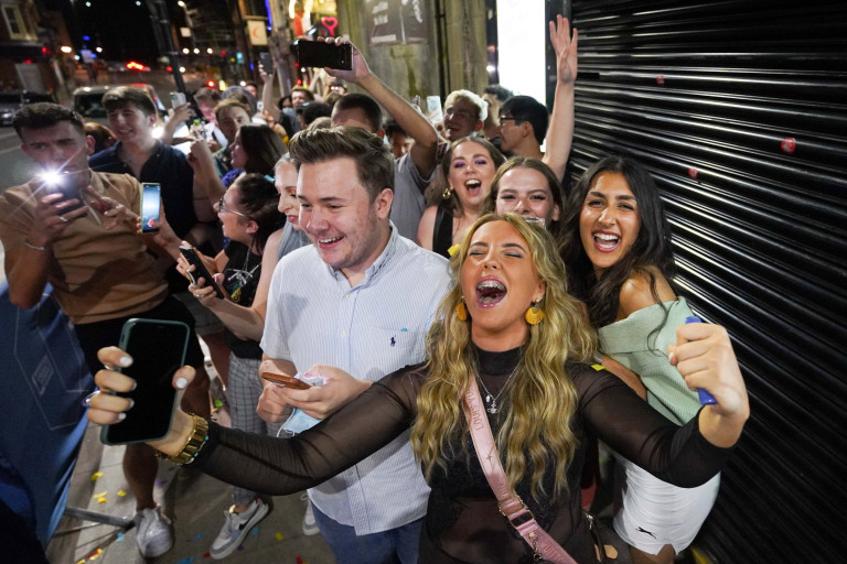 People queuing for Bar Fibre in Leeds, after the final legal coronavirus restrictions were lifted in England at midnight. Picture date: Monday July 19, 2021. PA Photo. See PA story HEALTH Coronavirus. Photo credit should read: Ioannis Alexopoulos/PA Wire