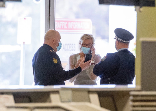 Sydney, AUSTRALIA - Katie Hopkins is escorted by NSW police to Sydney airport after having her visa canceled. The Australian government has canceled Katie Hopkins??? visa after the far-right commentator boasted about breaching hotel quarantine conditions. The cancellation was announced by the home affairs minister, Karen Andrews, on Monday ??? and follows a decision by Endemol Shine Australia to cancel her contract to appear on Seven Network???s Big Brother VIP. Hopkins will now be required to leave the country. Pictured: Katie Hopkins BACKGRID USA 19 JULY 2021 USA: +1 310 798 9111 / usasales@backgrid.com UK: +44 208 344 2007 / uksales@backgrid.com *UK Clients - Pictures Containing Children Please Pixelate Face Prior To Publication*
